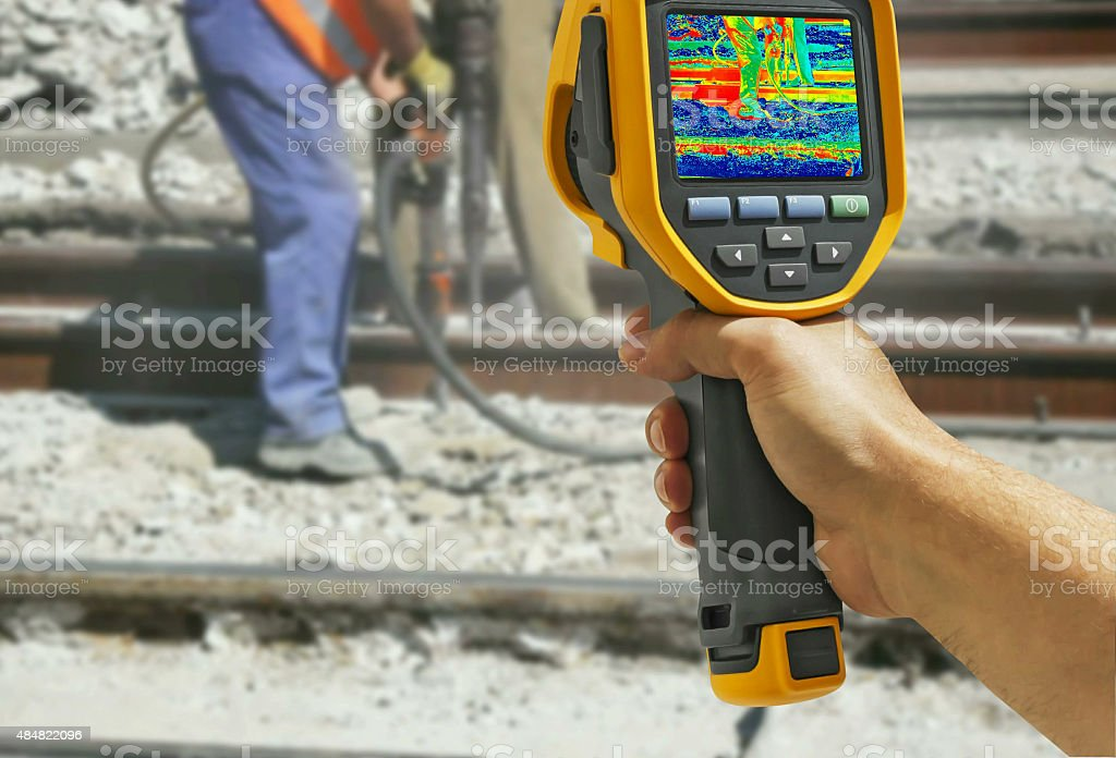 Recording with Infrared camera Two Workers stock photo