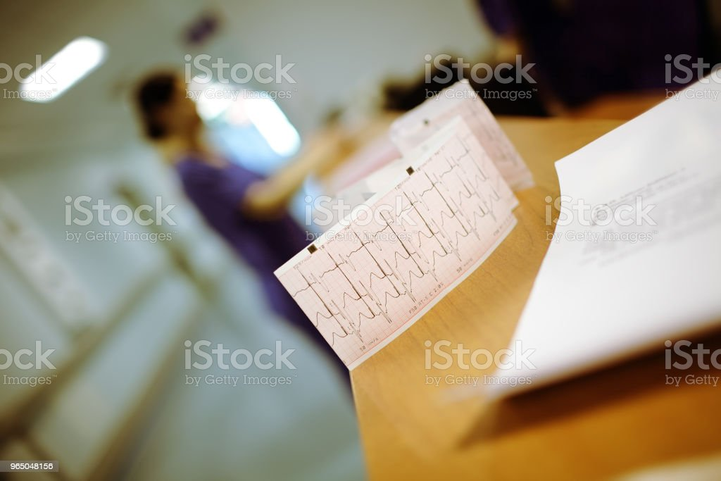 Records of patient examination on the nurse's table zbiór zdjęć royalty-free