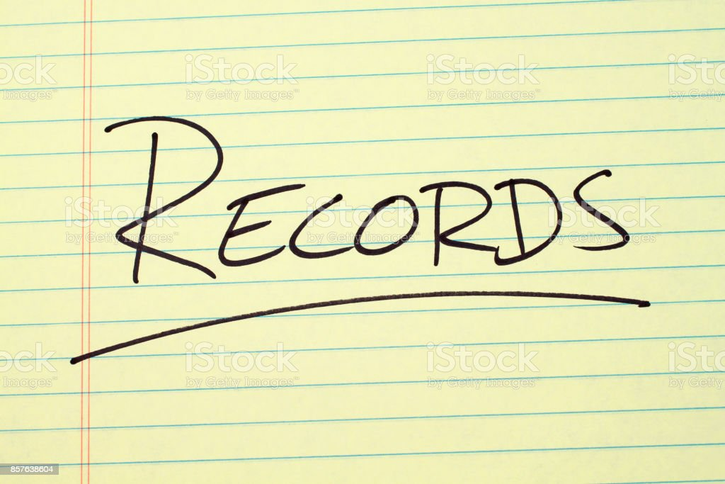 Records On A Yellow Legal Pad stock photo