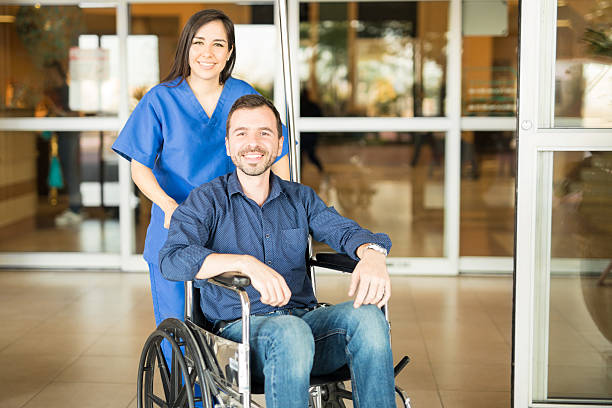 Recovered patient leaving the hospital stock photo