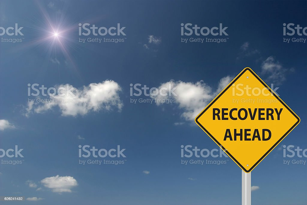 Recovery ahead warning sign concept stock photo