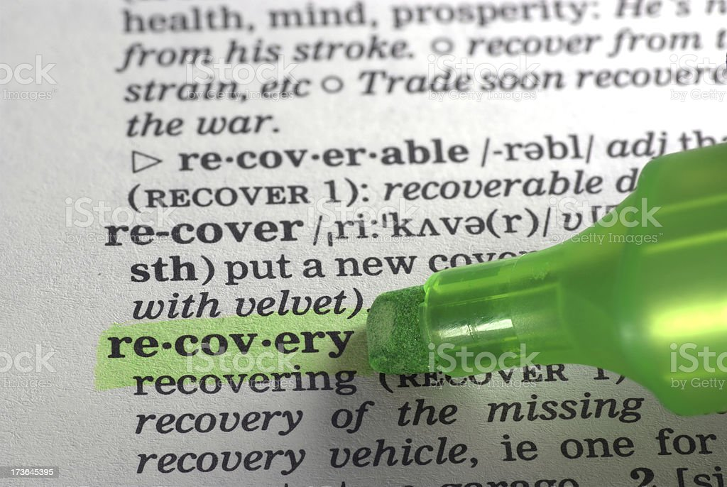 recovery defintion highlighted in dictionary stock photo