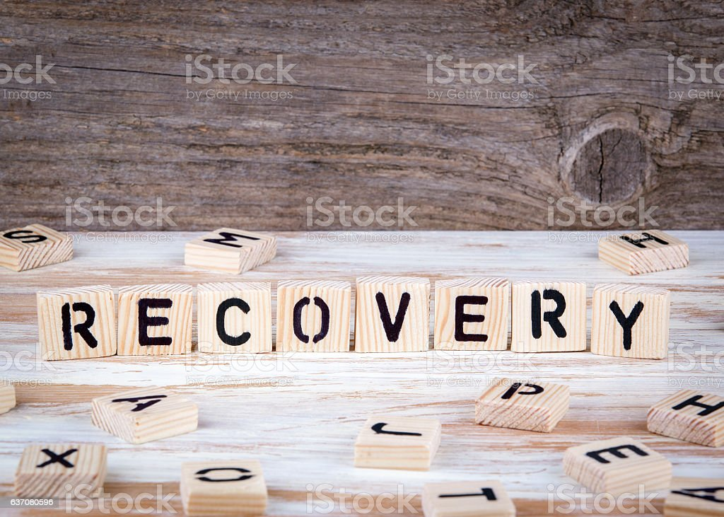 Recovery from wooden letters stock photo