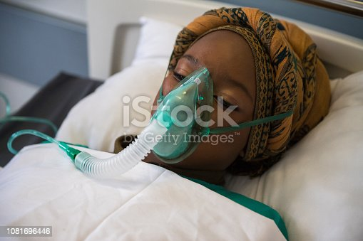 Patient with an oxygen mask