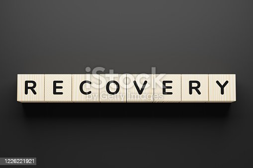 Recovery - word on wooden cubes, top view.