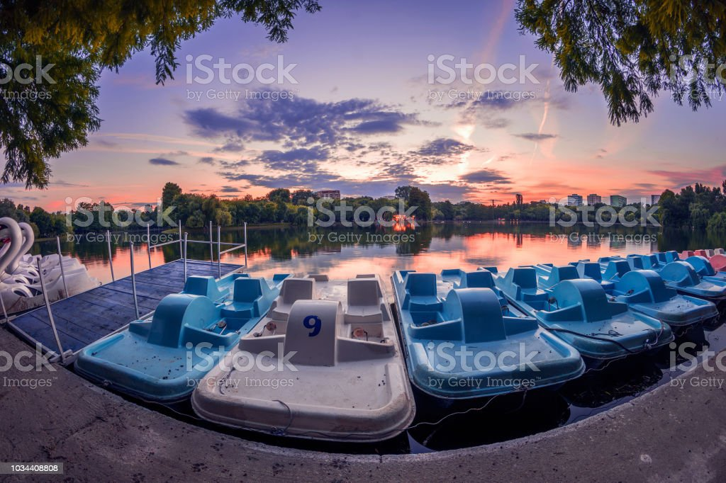 Recreation boats on a lake at sunset stock photo