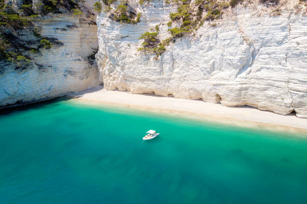 Recreation small boat in Natural park Gargano with beautiful turquoise sea stock photo