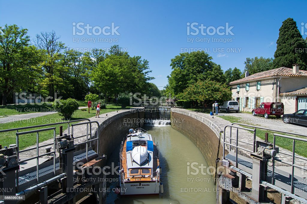 Recreational boat entering a lock in the Canal du Midi stock photo