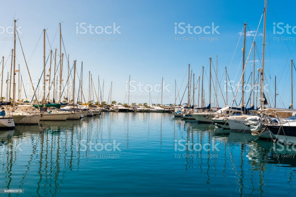 recreational boat moored in marina stock photo