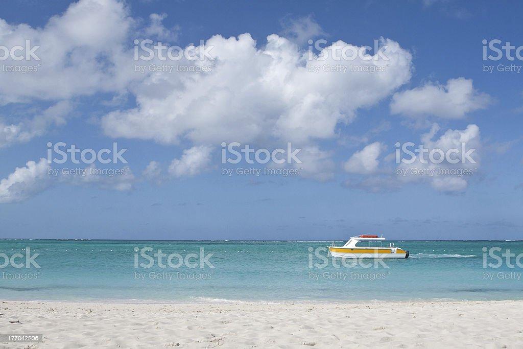 Recreational boat on turquoise Caribbean Sea stock photo
