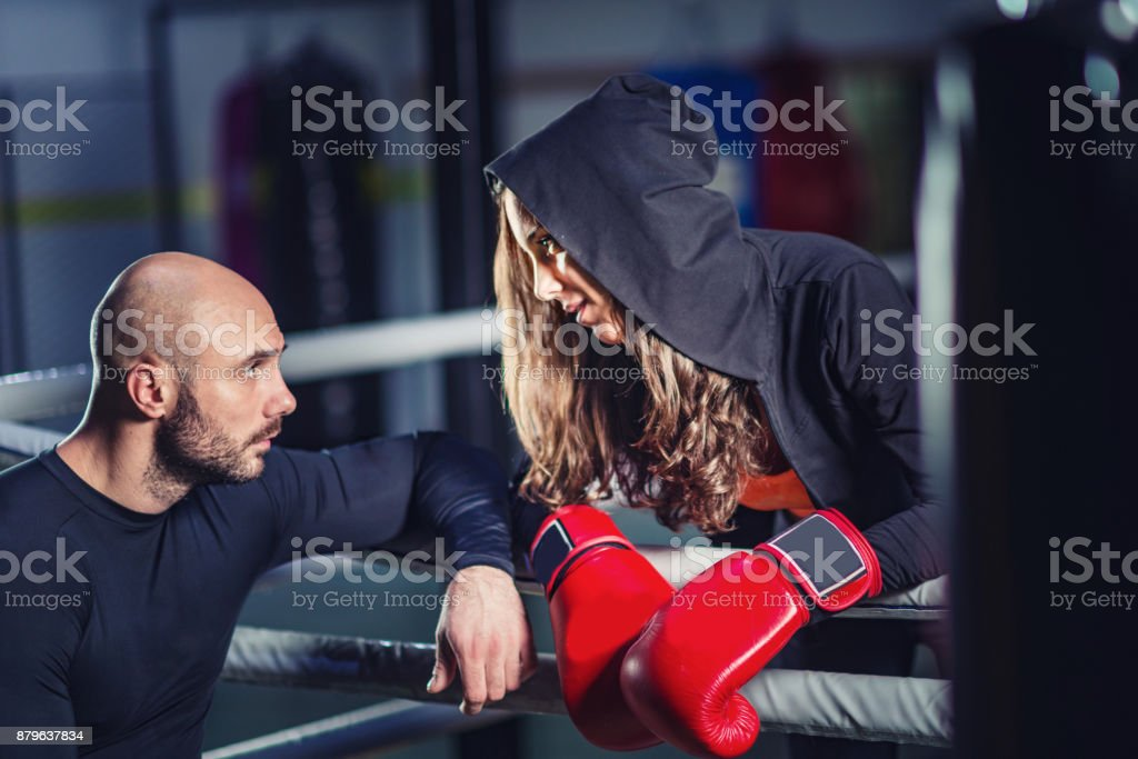 Recreational boxing, young woman with instructor stock photo