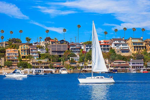 Recreational sailboat on Newport Bay at Newport Beach, CA stock photo