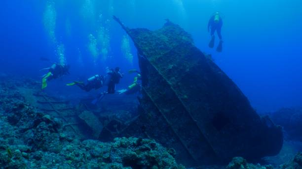 recreational scuba divers in underwater wreck - wreck diving stock pictures, royalty-free photos & images