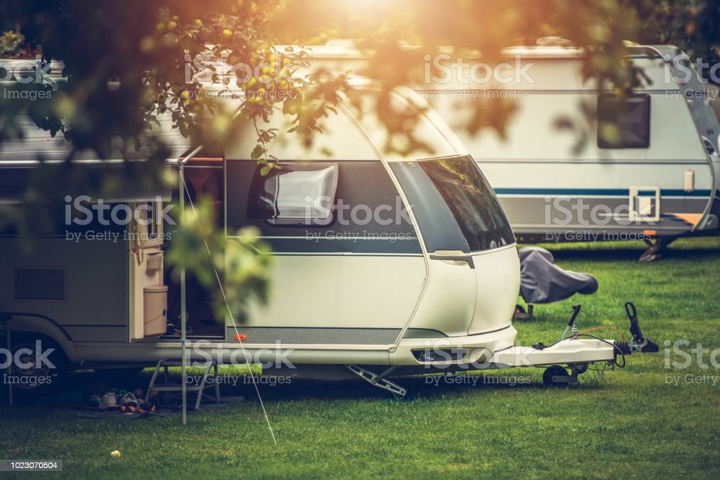 Recreational Vehicle Camping Recreational Vehicle Camping. Vacation in a Travel Trailer. RV Theme. Camper Trailer Stock Photo