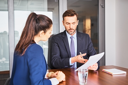 istock Recruiter conducting business job interview with female applicant in office 1032556104