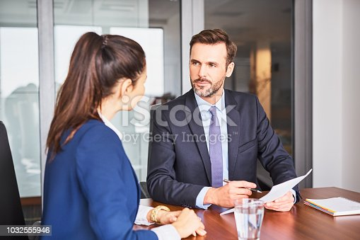 istock Recruiter during business job interview in office with female candidate 1032555946