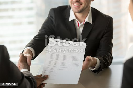 istock Recruiter giving employment agreement to applicant 843534094