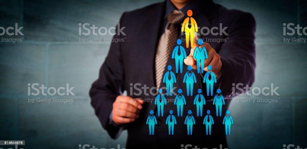 Recruiter Selecting Man Atop Corporate Hierarchy stock photo