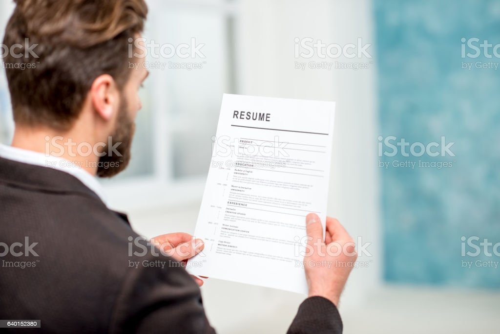 Recruiter with resume paper stock photo