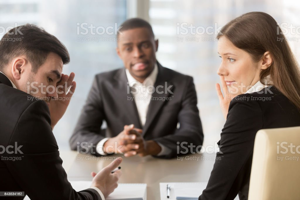 Recruiters covertly deciding to refuse applicant stock photo