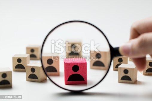 Searching for talent or looking for employee concept using magnifying glass and wooden cube with people icon