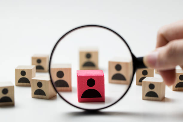 Recruitment concept searching for employee Searching for talent or looking for employee concept using magnifying glass and wooden cube with people icon magnifying glass stock pictures, royalty-free photos & images