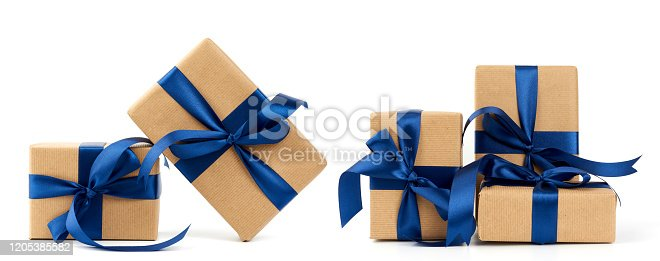 rectangle box wrapped in brown kraft paper and tied with a silk blue ribbon, gift isolated on a white background, set