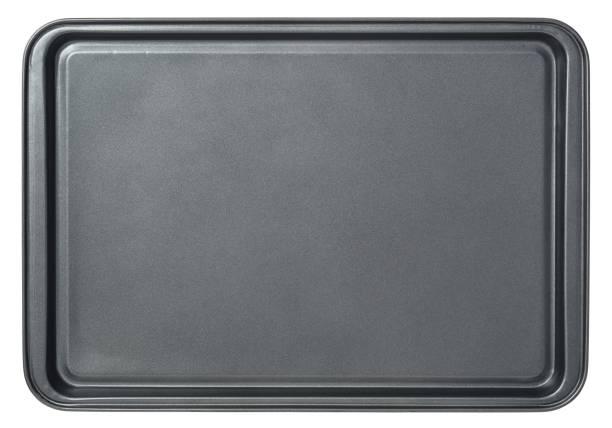 rektangulär svart bakplåt i ugn, isolerad på vit bakgrund. ovanifrån bakplåt - bakplåt bildbanksfoton och bilder