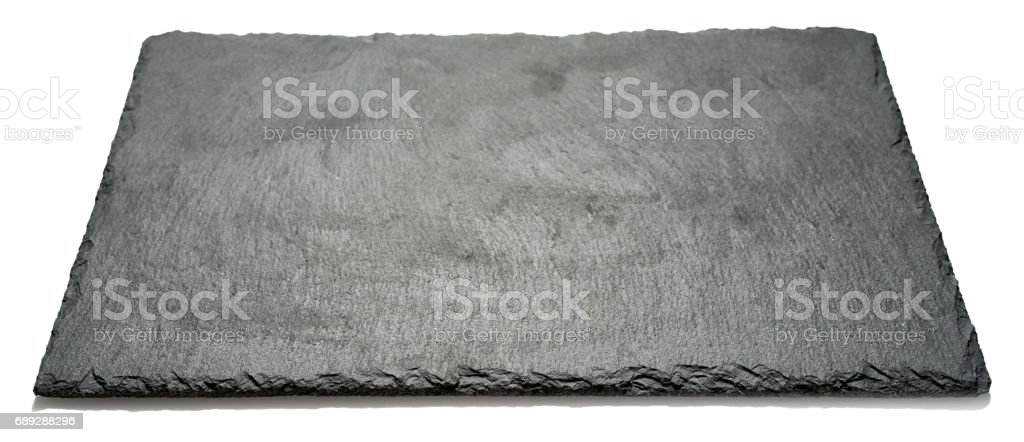 Rectangular black textured slate board for dishes isolated on white background, side angle view with perspective stock photo