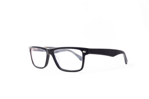 Rectangular black-rimmed glasses are located frontally on a white background. Isolated. stock photo