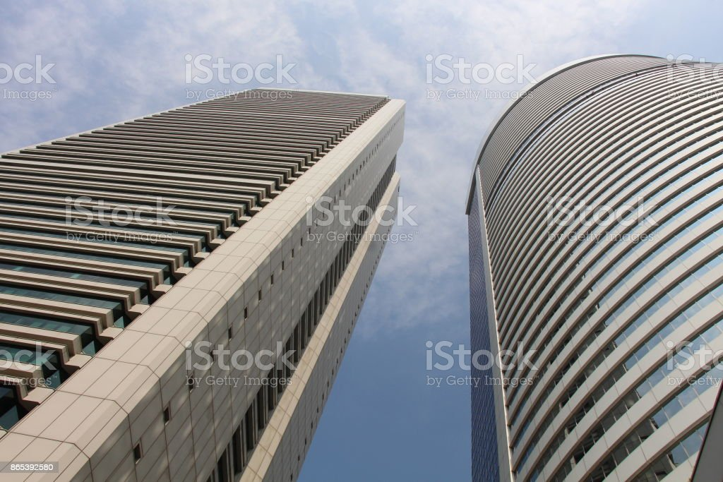 Rectangular block and a cylindrical hotel stock photo