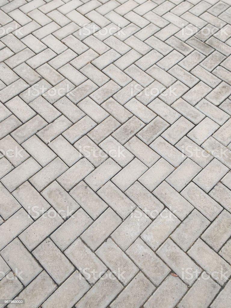 Rectangular cement block floor in zigzag pattern. stock photo