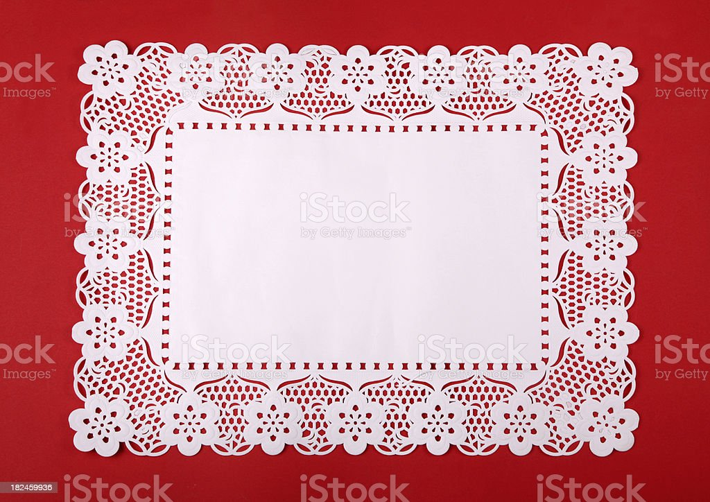 Rectangular doily on red cardboard stock photo