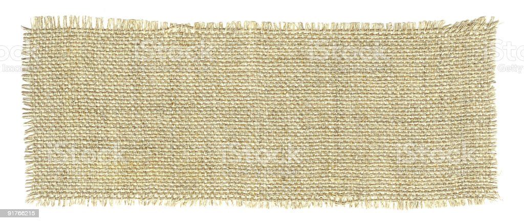 Rectangular piece of brown canvas with frayed edges stock photo