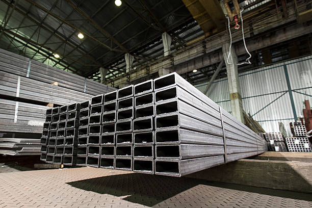 rectangular stainless steel bars deposited in stacks - hohl stock-fotos und bilder