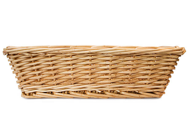 Rectangular wicker basket on white background  Wicker Basket shot from the front, isolated on white. wicker stock pictures, royalty-free photos & images
