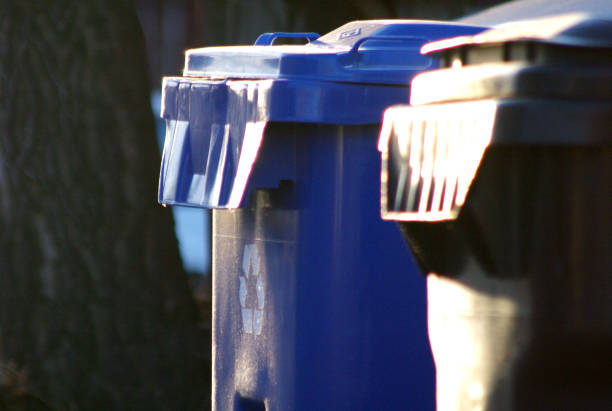 Recycle and garbage bins stock photo