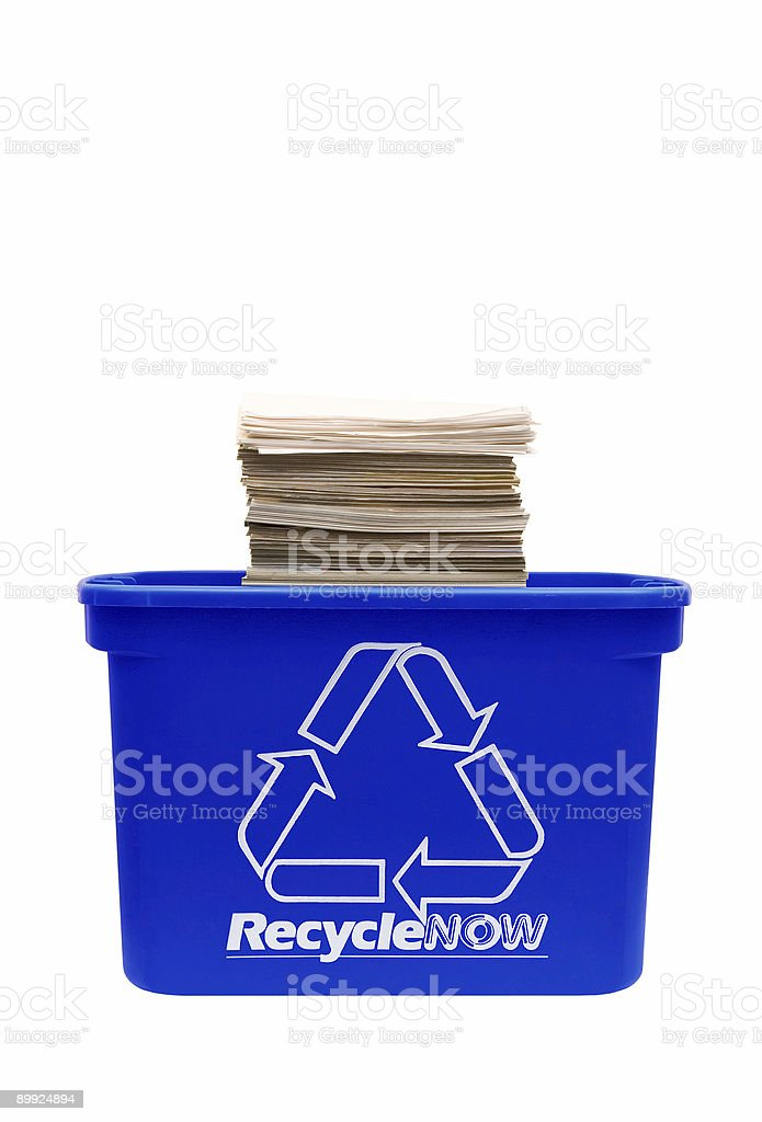 Recycle bin filled with paper royalty-free stock photo