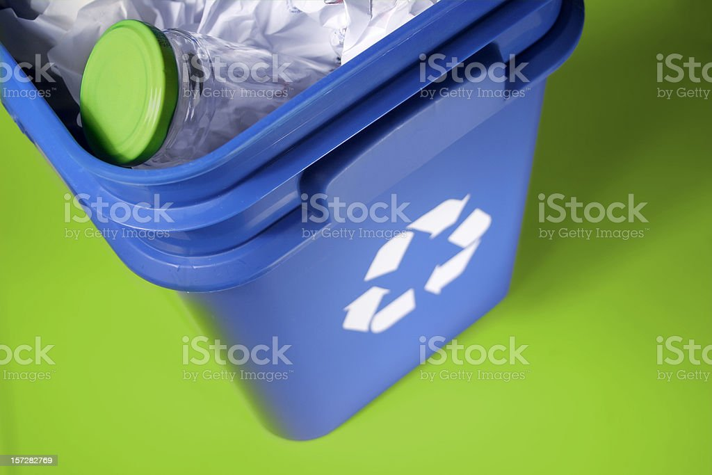 Recycle bin on green background royalty-free stock photo