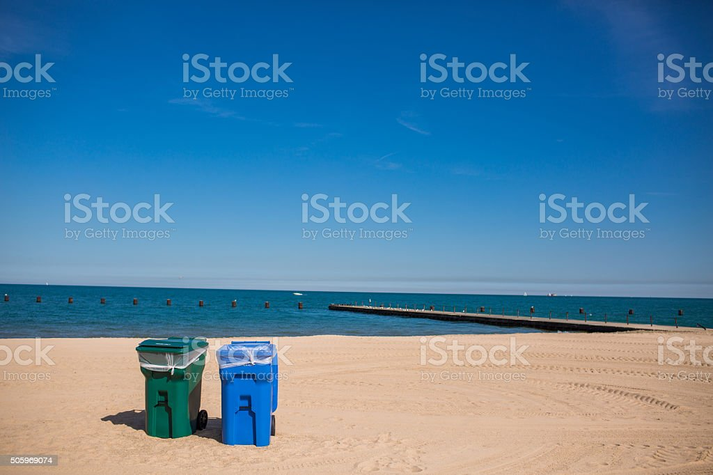 Recycle bins on the beach stock photo