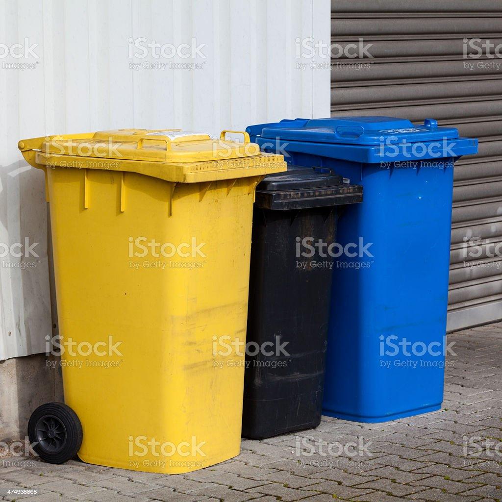 Recycle Bins. Three plastic bins stock photo