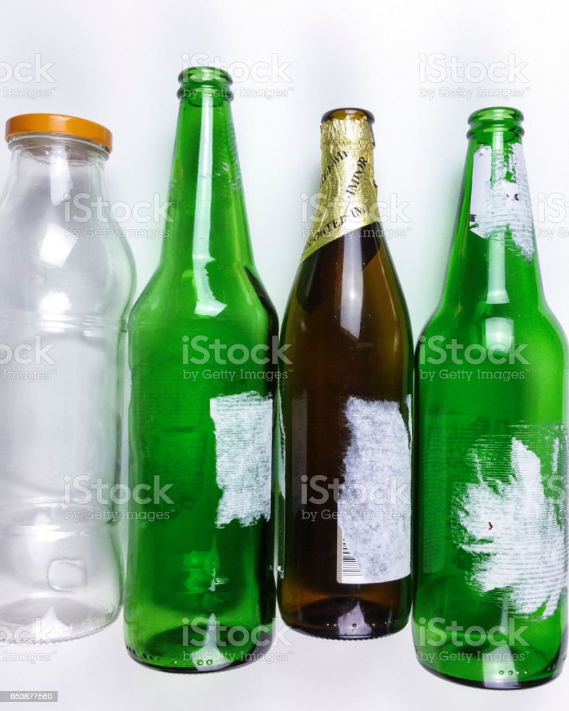 Recycle empty glass bottle on white background - top view stock photo