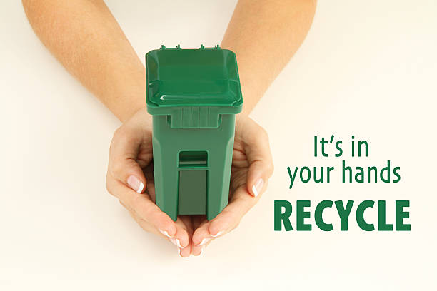 Recycle, it's in your hands stock photo