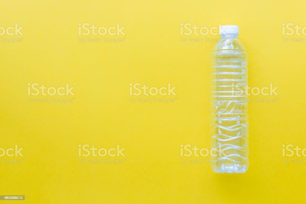 Recycle Plastic bottles on yellow color background - Zbiór zdjęć royalty-free (Bez ludzi)