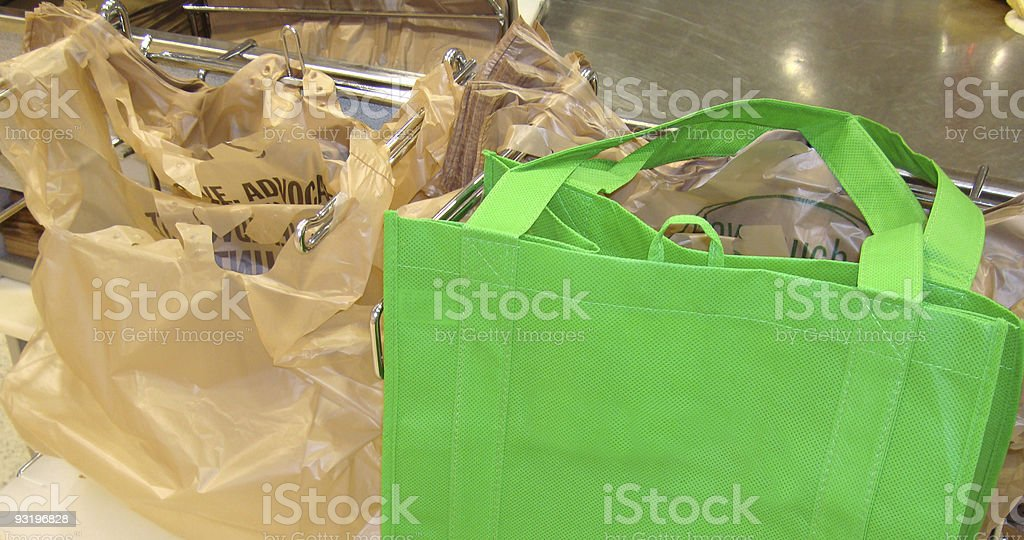 Recycle & Reuse Paper Or Plastic? Neither. stock photo