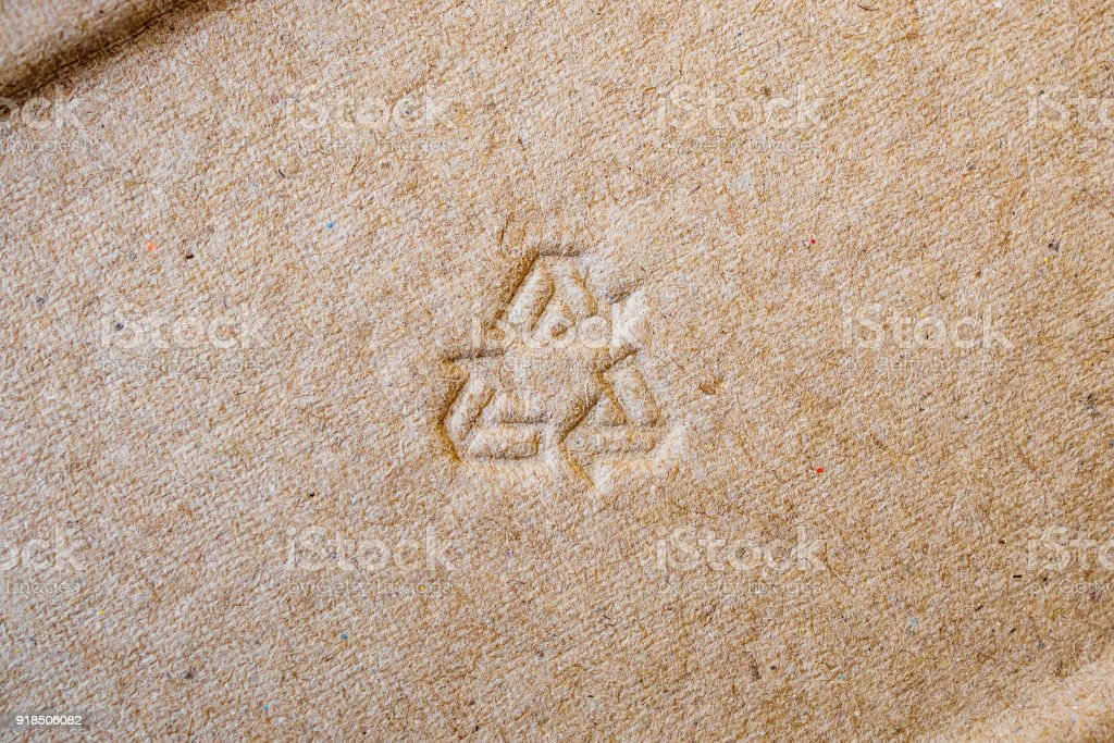 recycle sign on brown paper texture background royalty-free stock photo