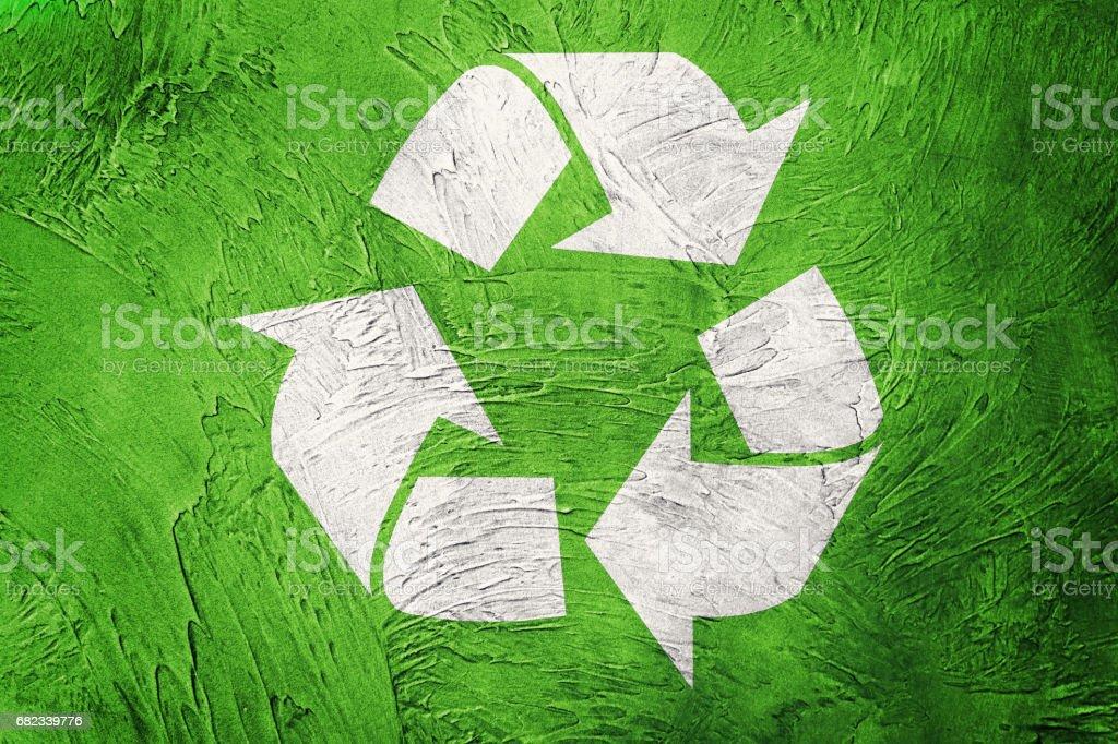 Recycle symbol on Grunge background. Vintage style. royalty free stockfoto