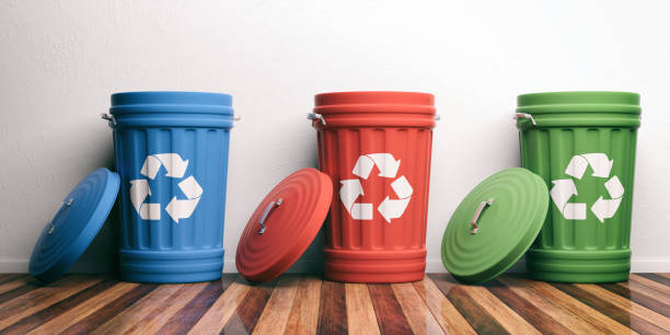 recycle trash bins on wooden floor. 3d illustration - bin stock pictures, royalty-free photos & images