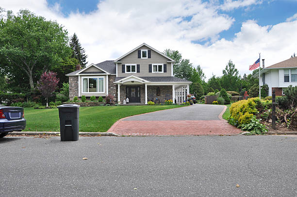 Recycle Trash Container on Suburban Home Curb stock photo