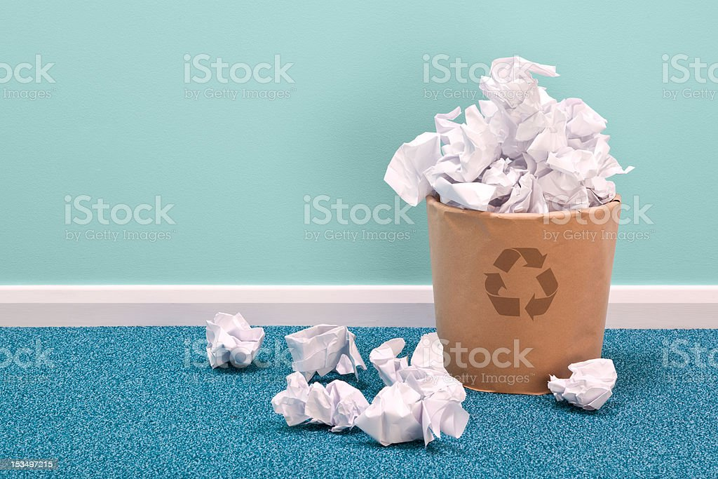 Recycle waste paper basket on office floor stock photo